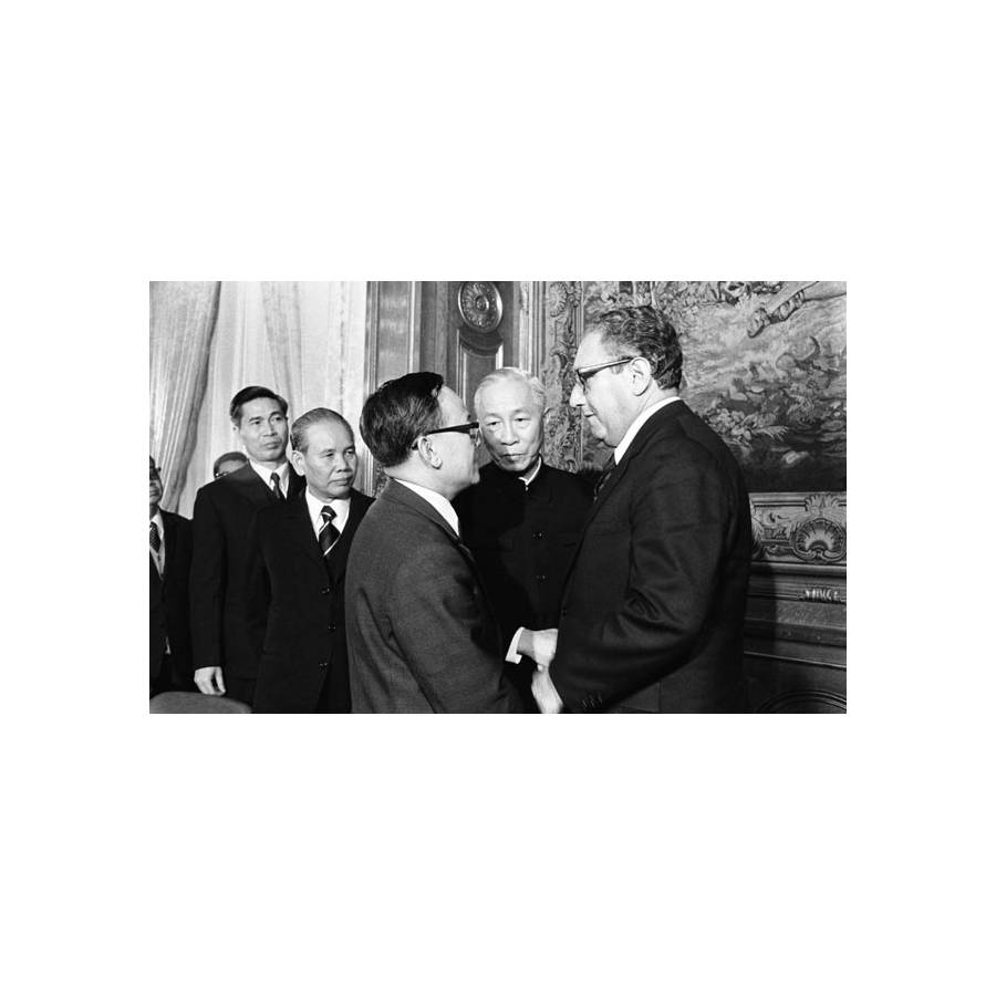 Henry A Kissinger And Le Duc Tho Shake Hands After Initiating The