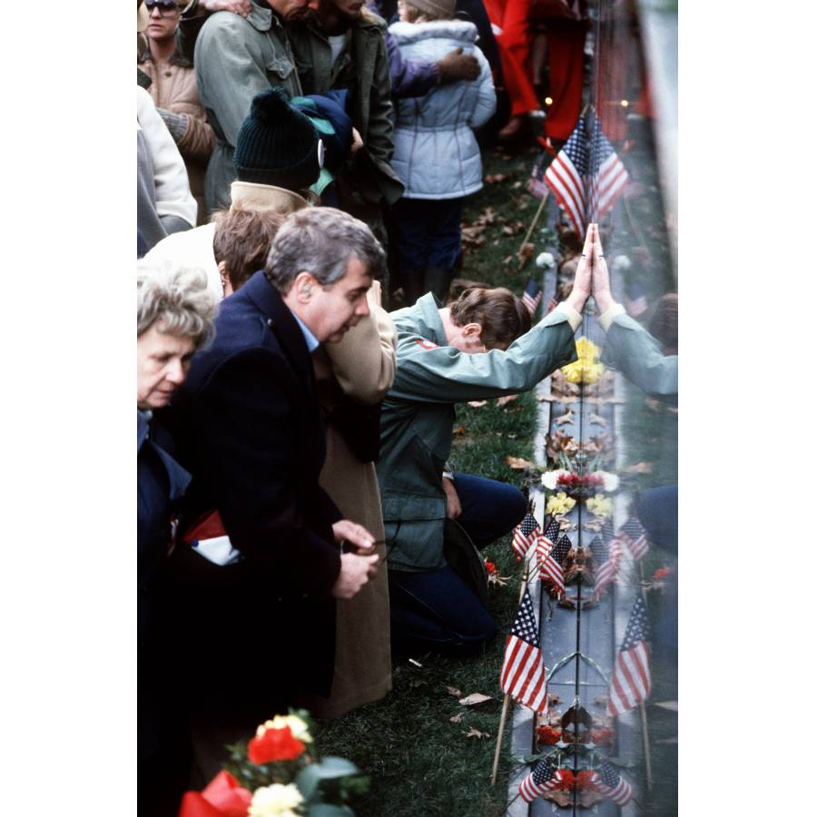 Visitors Search For Names On The Vietnam Veterans Memorial