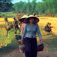 Marines on Patrol Duty in Vietnam and Vietnamese Women
