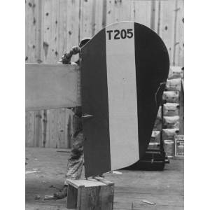 A Worker Installs a Tail with the Iconic Allied Colour Pattern