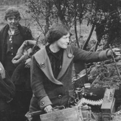 Civilians Liberated by the British Looking at a German Machine Gun Nest near their Home