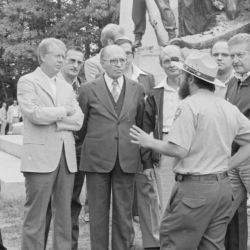 Jimmy Carter, Anwar Sadat, Menahem Begin and delegates from the Camp David Summit listen to a tour guide during a trip to the Gettysburg National Military Park