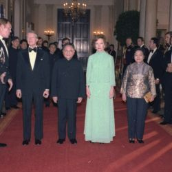 Jimmy Carter, Deng Xiaoping, Rosalynn Carter and Madame Zhuo Lin stop for a formal pose on their way to the state dinner for the Vice Premier of China.