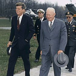 Meeting with President Eisenhower. President Kennedy, President Eisenhower, military aides. Camp David, MD.