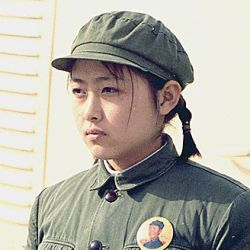 Young girl dressed in soldier attire at the arrival of the press plane in Peking, China