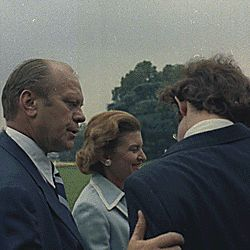 Vice President Ford consoling David Eisenhower as Nixon departs from the White House