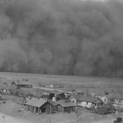 "Dust Storm in Rolla, Kansas; ""05/06/35; Dear Mr. Roosevelt, Darkness came when it hit us. Picture taken from water tower one hundred feet high. Yours Truly, Chas. P. Williams."" Photo: Massive Dark clo"