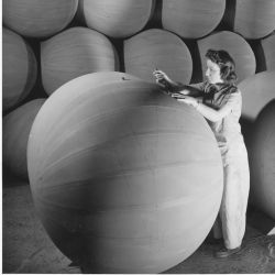 Woman worker applying the finishing touches to a flotation bag used to support airplanes forced down at sea