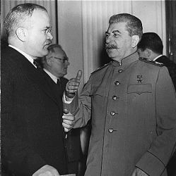 Russian Premier Stalin talks with gestures to his Foreign Minister Molotov at the Palace, Yalta, Crimea, Russia.