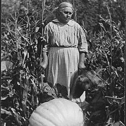 Woman with large pumpkin at Cass Lake