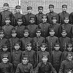 Early class of young men in uniform at the Albuquerque Indian School