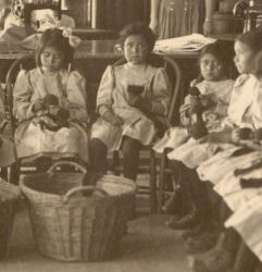 Young school girls attending sewing class at Albuquerque Indian School