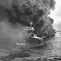 Naval photograph documenting the Japanese attack on Pearl Harbor, Hawaii which initiated US participation in World War II. Navy