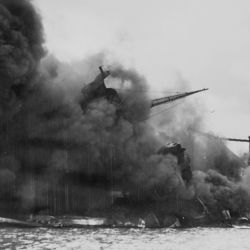 Naval Photograph Documenting the Japanese Attack on Pearl Harbor, Hawaii which Initiated US Participation in World War II.
