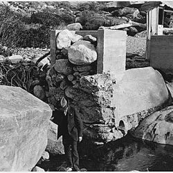 Aqua Caliente Reservation. Andreas Canyon Dam washed out February 1927. Rocks in the abutment removed 3/10/28