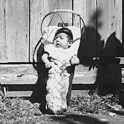 Native American chilld in cradle board. Taholah Agency