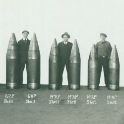 Workmen Displaying Various Types and Sizes of World War I Era Shells