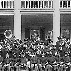 Carlisle Indian School Band Seated on Steps of a School Building, Carlisle, Pennsylvania