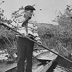 A Seminole spearing a garfish from a dugout