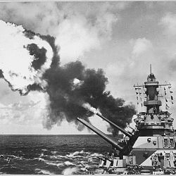 16 inch guns of the USS Iowa firing during battle drill in the Pacific.