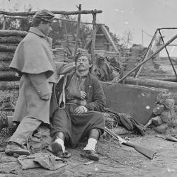 Scene showing deserted camp and wounded soldier. (Zouave)