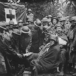 Wounded German prisoners receiving medical attention at first-aid station of 103rd and 104th Ambulance Companies. German second-line trench