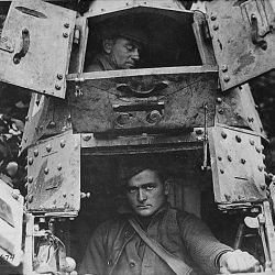 "With the Americans northwest of Verdun. The skipper and gunner of a ""whippet"" tank, with the hatches open. France"