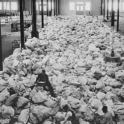 Small portions of the Christmas mail that is being sorted at Pier 86, North River, New York City, for the American Expeditionary Forces. The mail comes from every part of the country