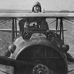First Lieutenant E. V. [Eddie] Rickenbacker, 94th Aero Squadron, American ace, standing up in his Spad plane. Near Rembercourt, France.