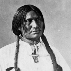 Big Foot (Sitanka), a Miniconjou Sioux of Cheyenne River Reservation, South Dakota; half-length, seated, wearing white shirt