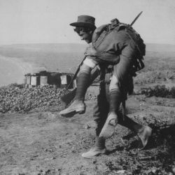 An Australian Bringing in a Wounded Comrade to Hospital
