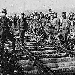 American Negro battalion building railroad. American Negro soldiers building a railroad in France