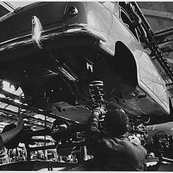"Italy. The begining of the ""1400"" assembly line. The bodies are lowered gently onto the chassis"