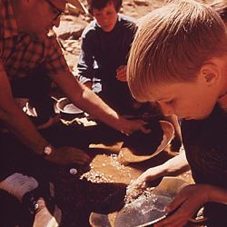 The Denver P.T.A. sponsored a week-long ecology workshop to introduce school children to the natural environment.  Here youngsters are taught to pan for gold in a creek