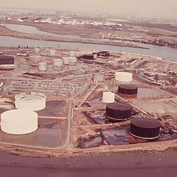 American Cyanimid and BP storage tanks on the New Jersey side of Arthur Kill, with Gulf Oil tanks on Staten Island in the background