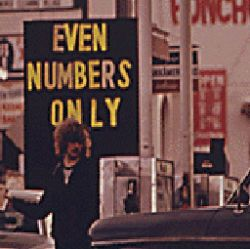 THE STATE OF OREGON WAS THE FIRST TO GO TO A SYSTEM OF ODD AND EVEN NUMBERS DURING THE GASOLINE CRISIS IN THE FALL AND WINTER OF 1973-74. HERE MOTORISTS WITH EVEN NUMBERED LICENSES LINE UP FOR GASOLIN