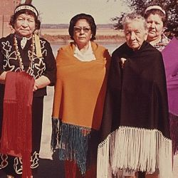 Four Women of the Iowa Indian Tribe are Shown Wearing a Modern Version of Their Costumes