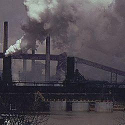 Coal Barge on the Monongahela River Moves Past a United States Steel Corporation Coke Plant