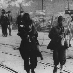[Survivors moving along the road after the atomic bombing of Nagasaki, Japan.]