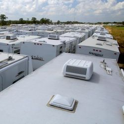 [Hurricane Katrina/Hurricane Rita] Baton Rouge, LA, October 1, 2005 -- A sea of white travel trailer tops stretches out into the horizon at a staging area set up to hold these temporary housing units