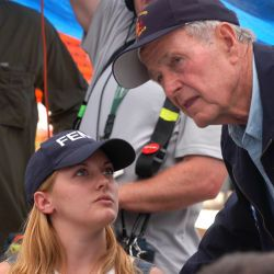 [Hurricane Katrina] Hancock County, Miss., September 8, 2005 -- Former President George H. W. Bush speaks with FEMA representative Meredith Chandler during his visit to the Waveland Disaster Recovery