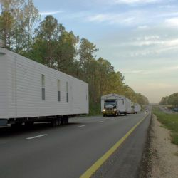 [Hurricane Katrina] Purvis, MS. October 8, 2005 - A convoy of FEMA trailers traveling South on MS interstate 59 on its way to southern Mississippi. Nicolas Britto/FEMA