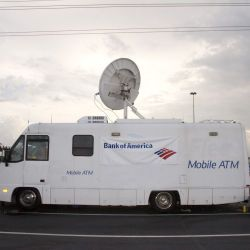[Hurricane Katrina] Houston, TX, September 8, 2005 -- Bank of America provided a mobile bank for debit card recipients