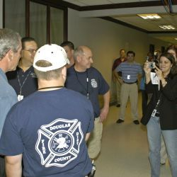 [Hurricane Katrina] Baton Rouge, LA, 9-25-05 -- President George W Bush takes time for a photo with FEMA Workers at the Joint Field Office. President Bush was in the area to gather first hand informat