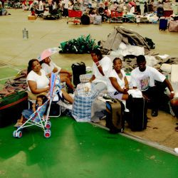 [Hurricane Katrina] Houston, TX, September 15, 2005 -- Kesha Chene, her daughter Destiny, her cousins Sherell, Richard and Kevin Donohue, Esienne and Walter Ramsey wait to move out. The Astrodome is b