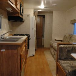 [Hurricane Katrina] Gautier, Miss., November 10, 2005 -- The living, dining and kitchen areas of a FEMA travel trailer. FEMA is providing travel trailers to residents of Mississippi displaced by Hurri