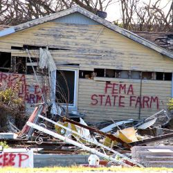 [Hurricane Katrina] Buras, LA, February 4, 2006 - Spray painted communications on the side of damaged homes identify insurance companies, the address of the home and items that are outside buy not con