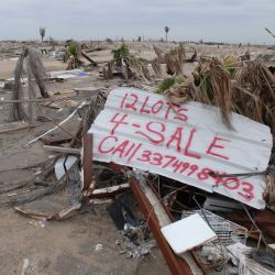 [Hurricane Katrina] Holly Beach, LA, 1-27-06 -- A sign by a local resident offering debris covered lots for sale. Some residents at Holly Beach are unable to clean up after Hurricane Rita and giving u