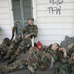 [Hurricane Katrina] Bywater, LA, 9/20/2005 -- Exhausted National Guardsmen take a break from patroling isolated communities around New Orleans. Only residents and emergency workers are allowed access