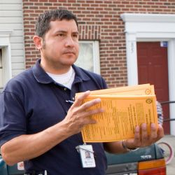 [Severe Storms and Inland and Coastal Flooding] Paterson, NJ, May 5, 2007 -- Community Relations field worker Faustino Salins delivers disaster information to residents in Paterson, N.J. Paterson was